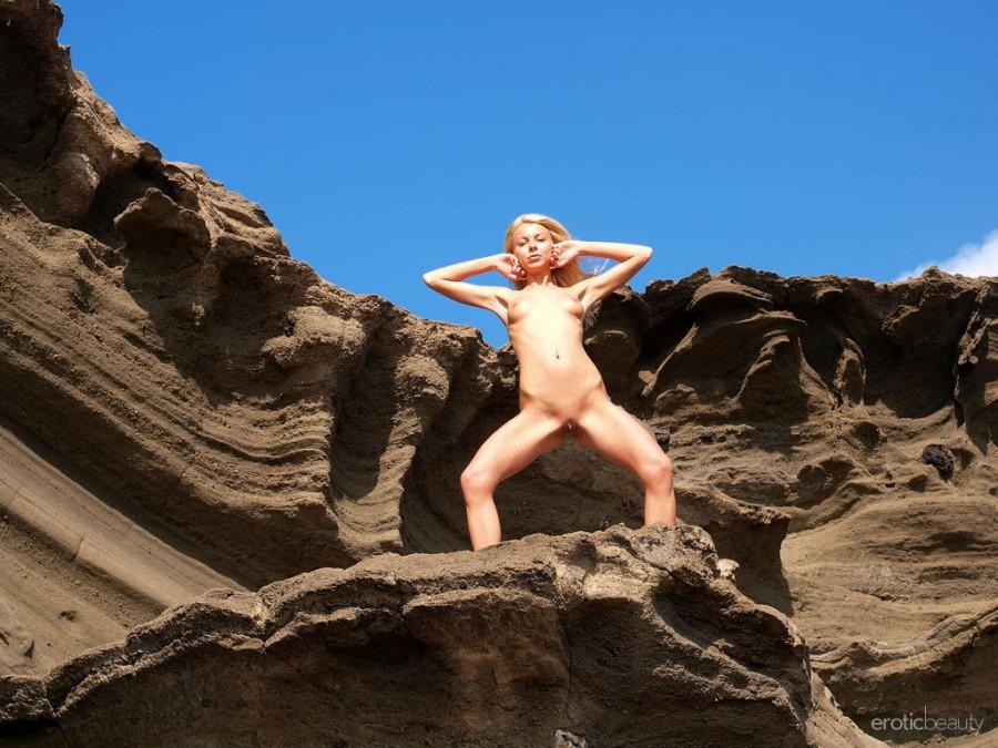 Naughty Blonde Judit in Sandy Oasis by Jan Vels